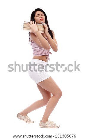 Latin schoolgirl trying to carry a heavy stack of books in full length pose, isolated on white background