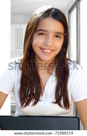 Latin teenager student smiling holding laptop indoor white house [Photo Illustration]