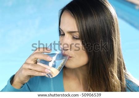 Latin woman drinking water
