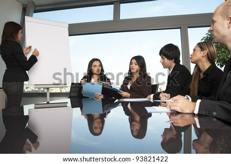 latin woman during boardroom presentation
