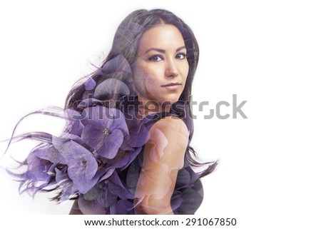 Stock Photo latin woman with blowing hair double exposure with a hortensia's flowers