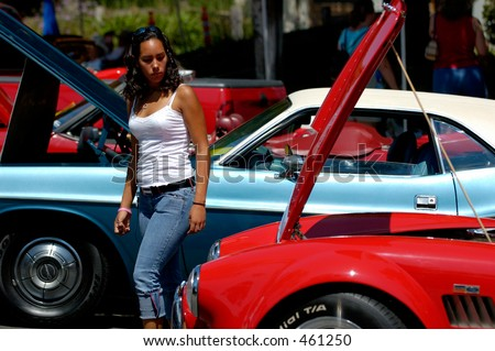 Latin young woman at Rodeo Drive car show. Beverly Hills, California.