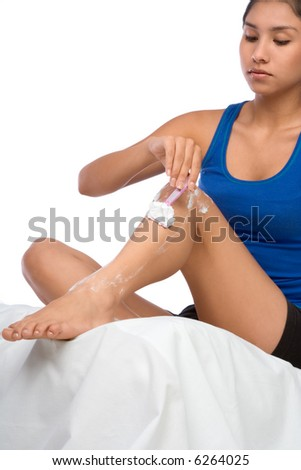 Latina girl shaves her legs - stock photo