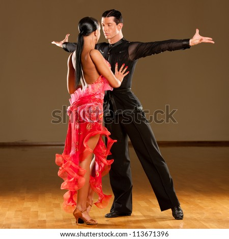 latino dance couple in action - rumba - stock photo