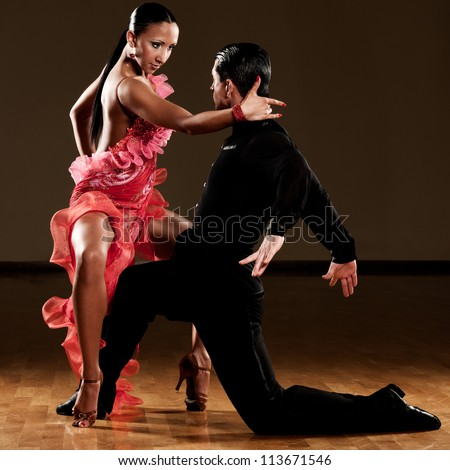 latino dance couple in action - wild pasodoble