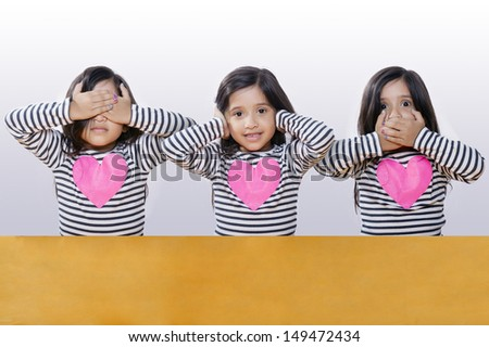 Latino girl with long hair and striped sweater poses for blind deaf dumb