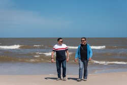 Latino men enjoying a day together at the beach in Uruguay, the man on the right is living with HIV
