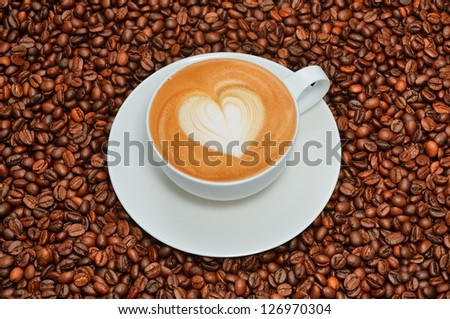 Latte art and coffee beans