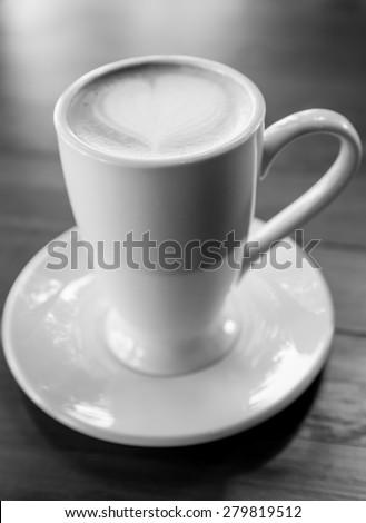 Latte Art coffee, cup of latte art coffee on wood table black & white
