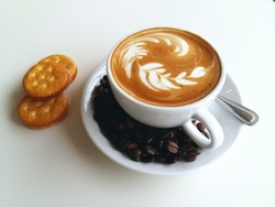 Latte art coffee with coffee bean and cracker so delicious on white
