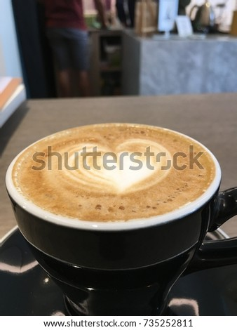 Latte art cup of coffee, cafe Background. #735252811