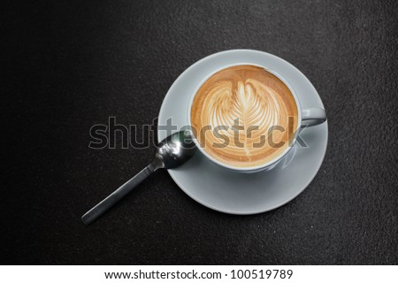 latte art in white cup.