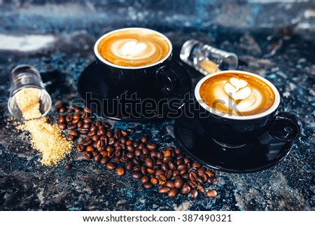 Latte art on espresso coffee. Black coffee served in bar #387490321