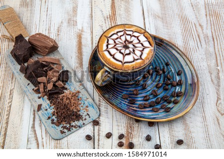 Latte art on wood table. a cup of coffee , cappuccino art, cappuccino.