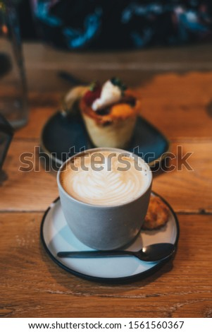 Latte Cafee with cupcake in the background #1561560367