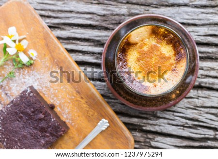 Latte Coffee and Chocolate Brownie Cake and Daisy Flower and Spoon on Cutting Board or Chopping Board on Wood Table Flatray or Top Table. Relax Coffee break time for food and drink category