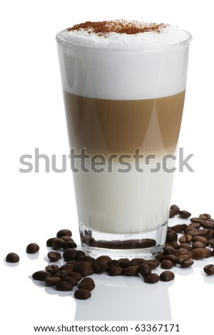 latte macchiato with cocoa powder and coffee beans on white background