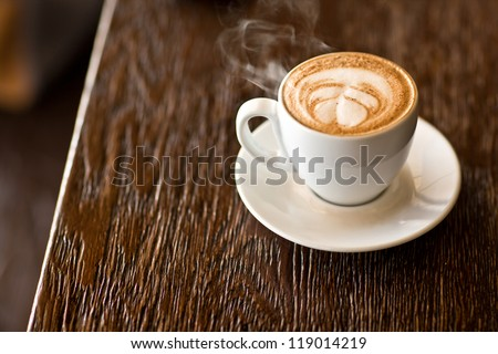 latte on a wood table