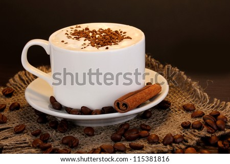 Latte on wooden table on brown background