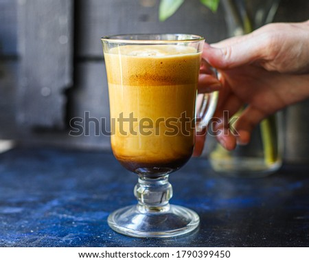 latte or cappuccino dalgona coffee in a transparent glass sweet hot drink cocoa with milk organic eating healthy top view place for text copy space