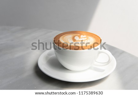 latte or Cappuccino with frothy foam, coffee cup top view on table in cafe. #1175389630