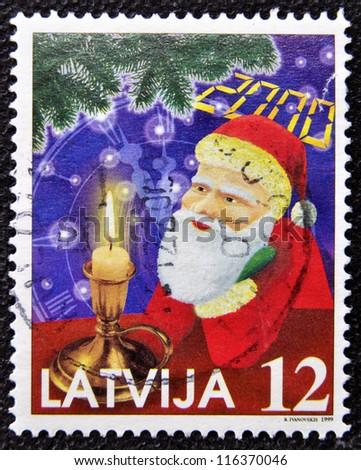 LATVIA - CIRCA 1999: A christmas stamp printed in Latvia shows papa noel, santa claus, circa 1999