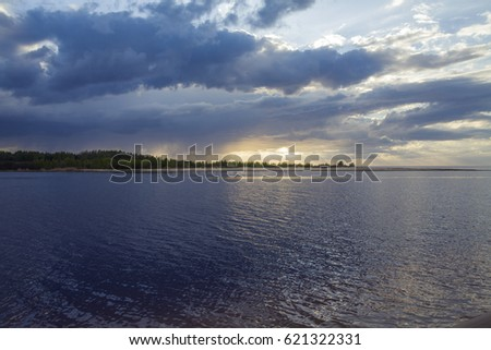 Latvia. Sunset on the river. Change in the weather. Elemental binge.  #621322331