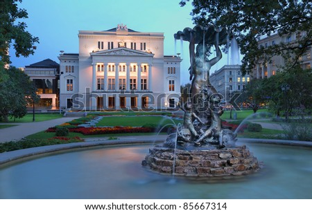 Latvian national opera and ballet theater and fountain the Nymph in park. Riga, Latvia.
