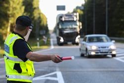 Latvian police man is directing traffic