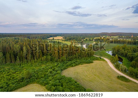 Latvian rural landscape with agricultural fields, forests and roads at sunset, aerial top view, soft focus aerial photoshot Сток-фото ©