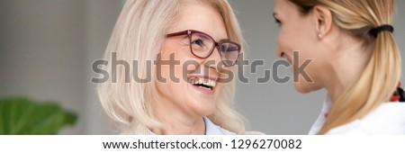 Laughing attractive aged young women have fun feel happy mother and daughter good relations two generations concept. Horizontal close up photo banner for website header design with copy space for text