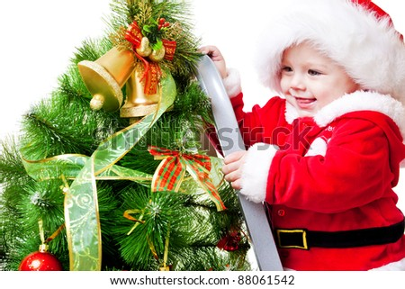 Laughing attractive baby decorating Christmas tree