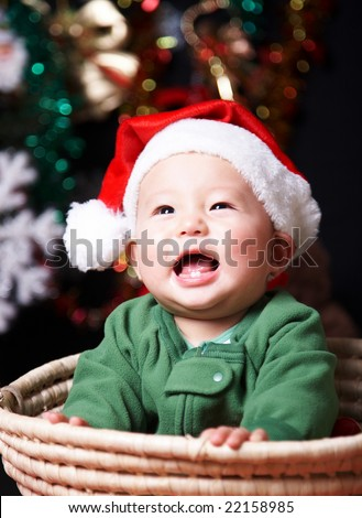 laughing baby in a santa hat.