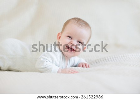 Laughing baby on bed