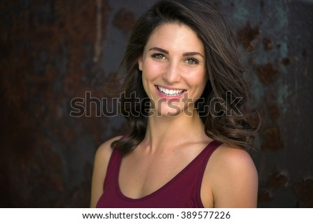 Laughing big white smile perfect straight teeth dental patient headshot female youthful genuine