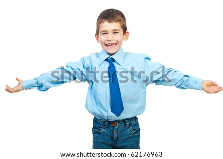 Laughing boy in elegant clothes standing with hands open to embrace someone isolated on white background