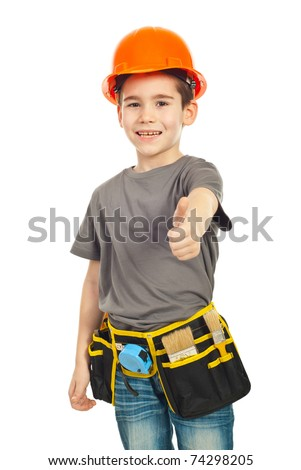 Laughing boy with worker tools and helmet giving thumb up isolated on white background - stock photo