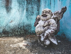 Laughing Buddha Statue - old destroyed statue of Laughing Buddha / Statue of kubera.