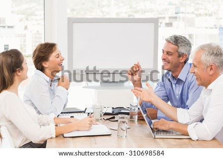 Laughing business people having a meeting in the office