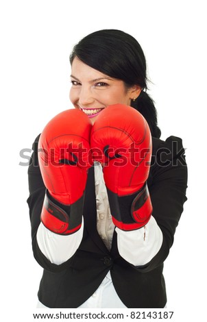 Laughing business woman wearing boxing gloves against white background