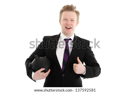 Laughing businessman holding a piggybank. Wearing a black suit with a purple tie. White background. - stock photo
