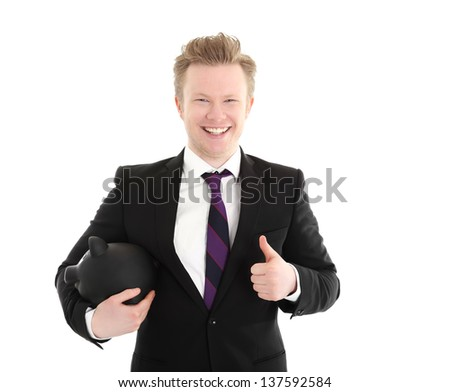 Laughing businessman holding a piggybank. Wearing a black suit with a purple tie. White background.