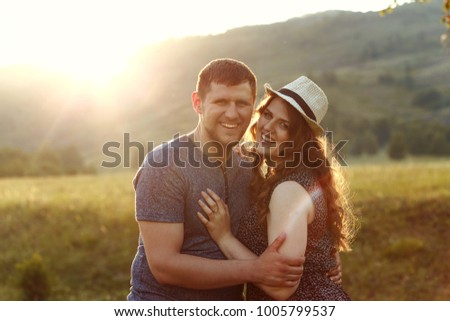 laughing couple in love at...