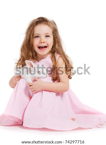 Laughing curly girl with white rabbit in hands