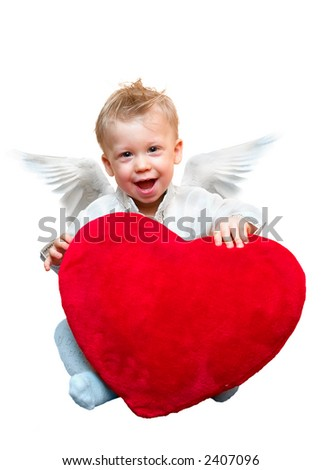 Laughing cute angel boy with big plush red heart. Isolated on white background