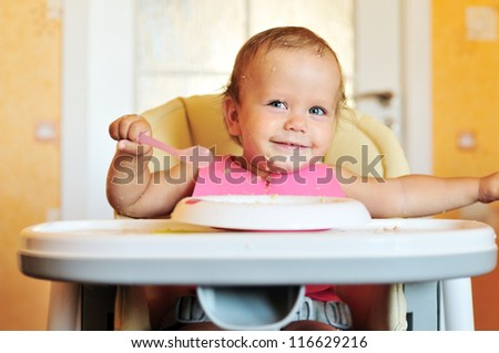 laughing eating baby girl with dirty face