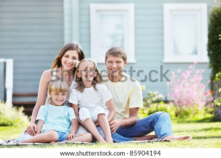 Laughing family with children outdoors