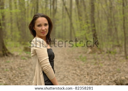 Laughing female in the spring forest