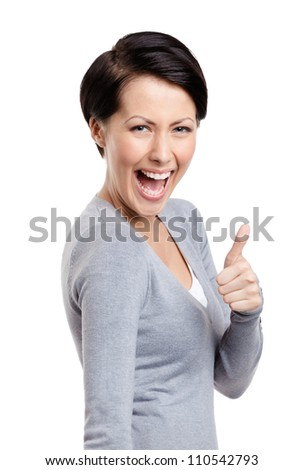 Laughing girl gives thumb up, isolated on white