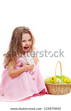 Laughing girl holding Easter bunny